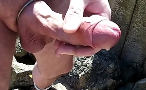 cock and balls show on the beach