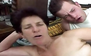 Hairy granny loves young cock