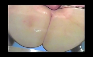 big fat oiled ass on a glass table