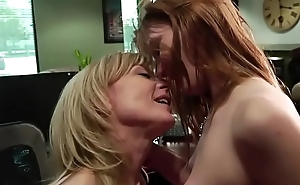 Blonde MILF seduces a lusty girl to fuck in her office
