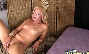 Glamcore tranny tugs and strokes her dick