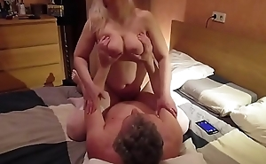 The husband eagerly fucks a busty wife in bed - iamandu.com