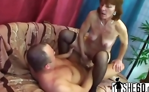 Redhead granny is craving for a dick