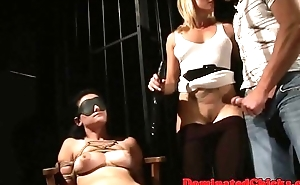 Restrained slave humiliated in a threesome